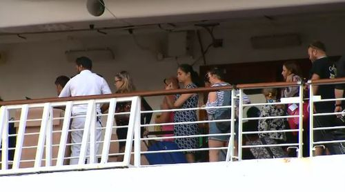 Cruise ship passengers were seen disembarking the ship in Sydney this morning. (9NEWS)