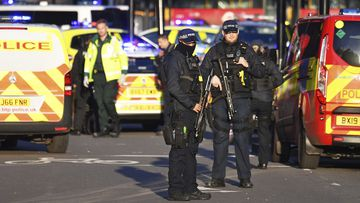Counter-terrorism police at the scene of the London attack.