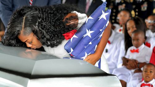 Myeshia Johnson, the wife of Army Sgt. La David Johnson, kisses her husband's casket during his funeral service last year. (AP).