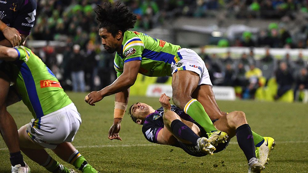 Canberra's Sia Soliola's sickening shot on Melbourne's Billy Slater. (AAP)