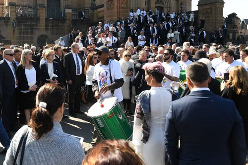 A Samba drummer plays at the State Funeral for veteran soccer broadcaster Les Murray at St. Mary's Cathedral in Sydney. (AAP)