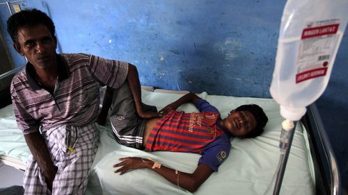 A Rohingya migrant is treated in a North Aceh local hospital after being rescued. (AAP)