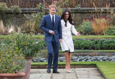 Harry and Meghan attend a photocall in the Sunken Gardens at Kensington Palace following the announcement of their engagement on November 27, 2017.