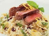 Warm lamb salad on avocado mint couscous