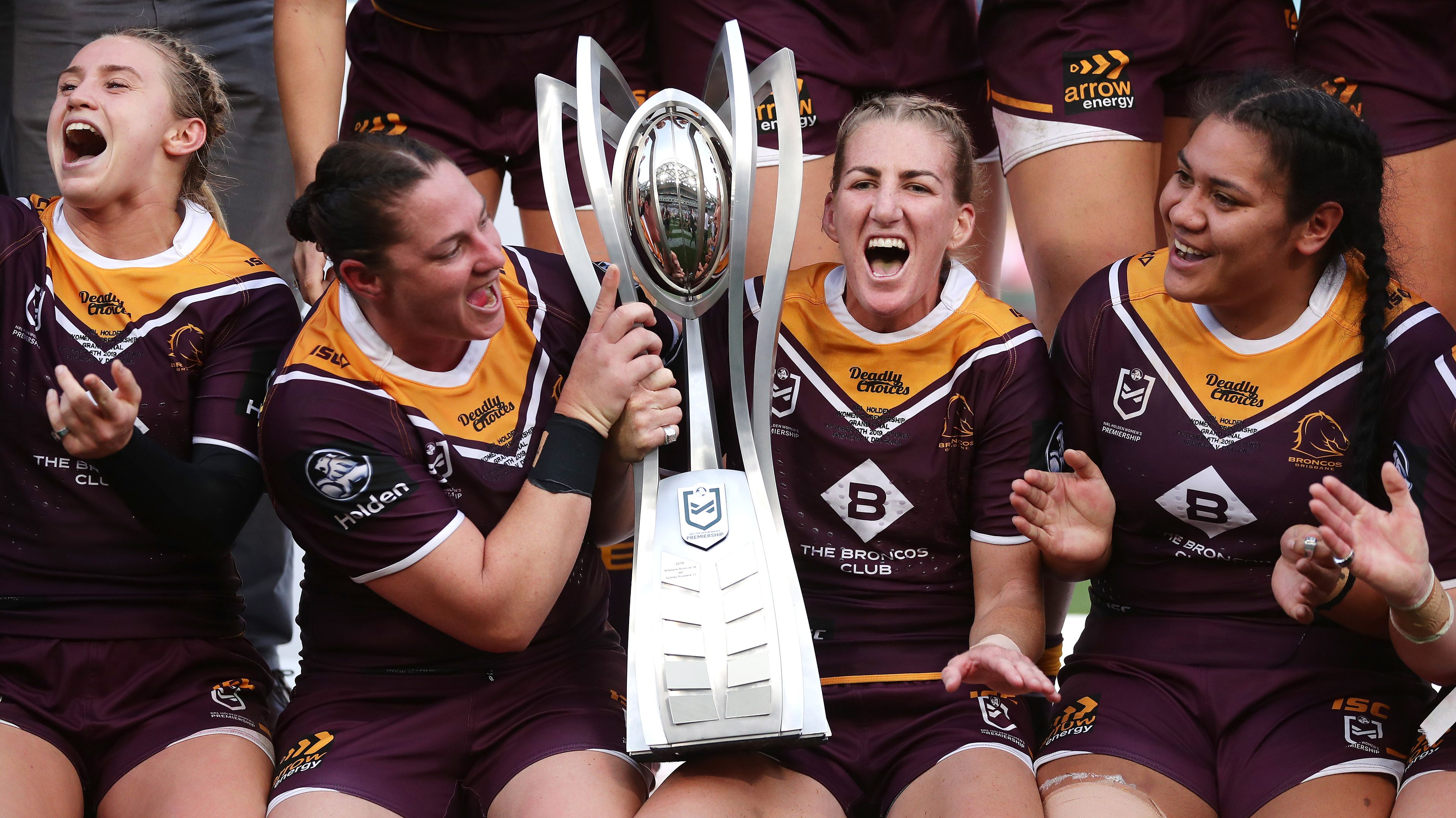 Broncos captain Ali Brigginshaw celebrates with teammates and the trophy.