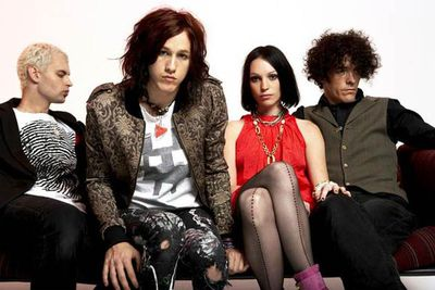 """Azaria — second from left, pictured with his band The Follow — first came to public attention as a contestant on <i>Popstars. </i>Shortly after appearing on the show he was bashed by viewers who didn't take to his, er, """"alternative"""" style. (Still, it couldn't have hurt as bad as losing <i>Popstars </i>to Scott Cam.)"""