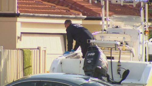 Forensics officers were on the scene, searching the Perth property for clues.