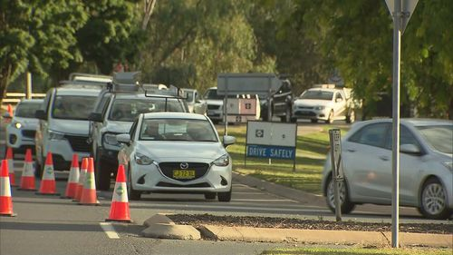 Queues are forming at checkpoints on the NSW and Queensland border.