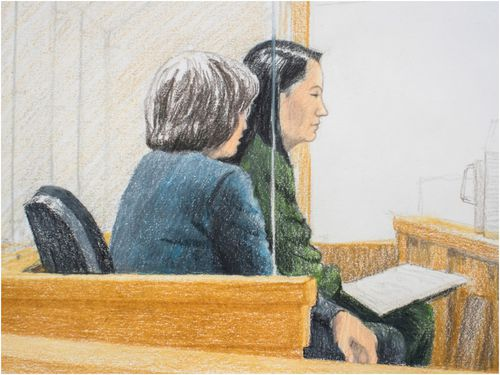 Courtroom sketch of Meng Wanzhou, the chief financial officer of Huawei Technologies, siting beside a translator in Vancouver Supreme Court.