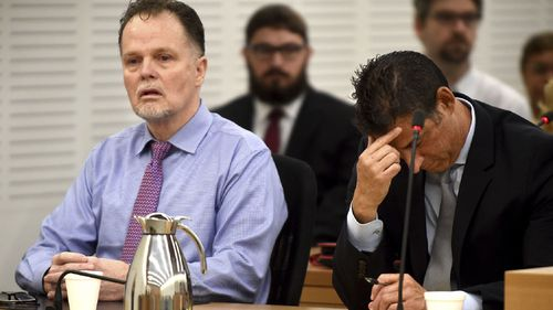 "Charles ""Chase"" Merritt, left, reacts in court after being found guilty of four counts of first-degree murder of the McStay family."