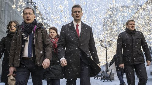 Russian opposition leader Alexei Navalny, who submitted endorsement papers necessary for his registration as a presidential candidate, center, heads to attend a meeting in the Russia's Central Election commission in Moscow, Russia (AAP).