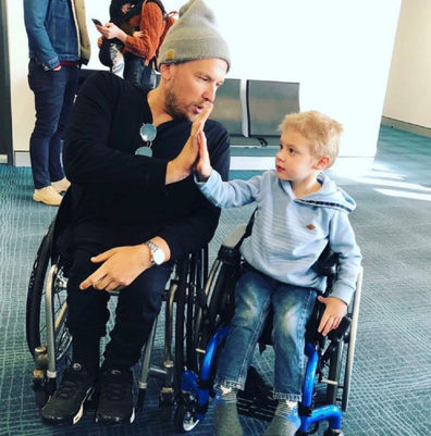 Dylan Alcott disability with a boy in a wheelchair