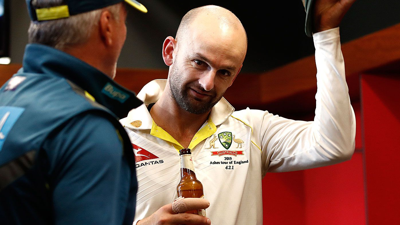 Nathan Lyon celebrates in the change rooms
