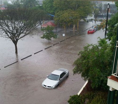 A flooded car in Fisher St, Brisbane. (Supplied, Jessy Webster)