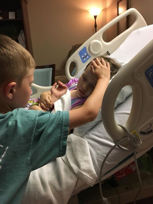 The heart-wrenching photo of Jackson Sooter comforting his little sister. Picture: Facebook