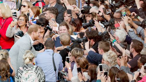 Hundreds swarm to meet Prince Harry on the eve of his wedding. Picture: AAP