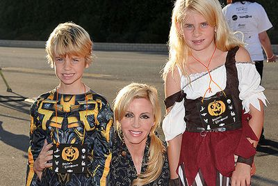 Camille Grammer with daughter Mason and son Jude, on their way to a Halloween party.