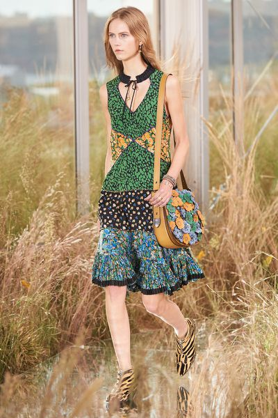 For Coach's first ever women's runway show, models waltzed down a catwalk of wildflowers and high grasses in patchwork dresses, ankle booties and '70s silhouettes.