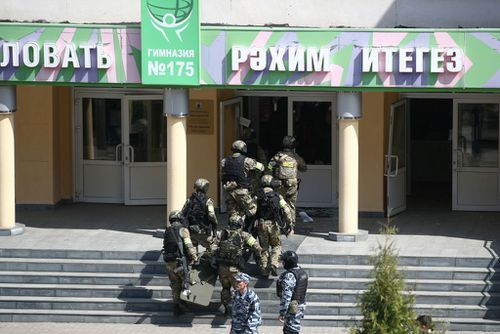 KAZAN, RUSSIA  MAY 11, 2021: FSB officers by school No 175 where two attackers opened fire; at least one teacher and eight students are reported dead. Yegor Aleyev/TASS (Photo by Yegor AleyevTASS via Getty Images)