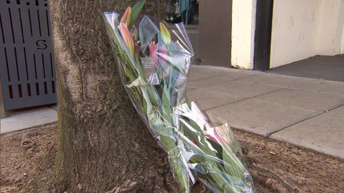 Flowers are laid at the scene of the tragedy.