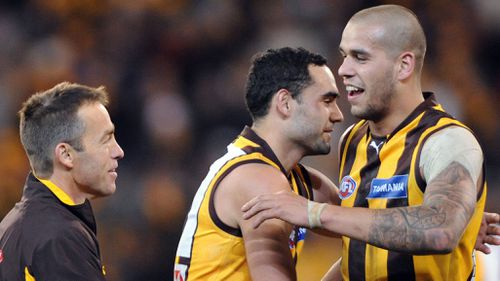 Hawthorn coach Alastair Clarkson celebrating with Shaun Burgoyne and Lance Franklin in happier times. (AAP)