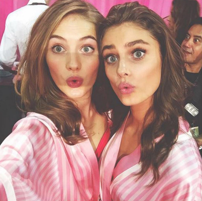 Sanne Vloet and Taylor Hill can't contain their surprise at the fashion show extravaganza. (Instagram/@sannevloet)
