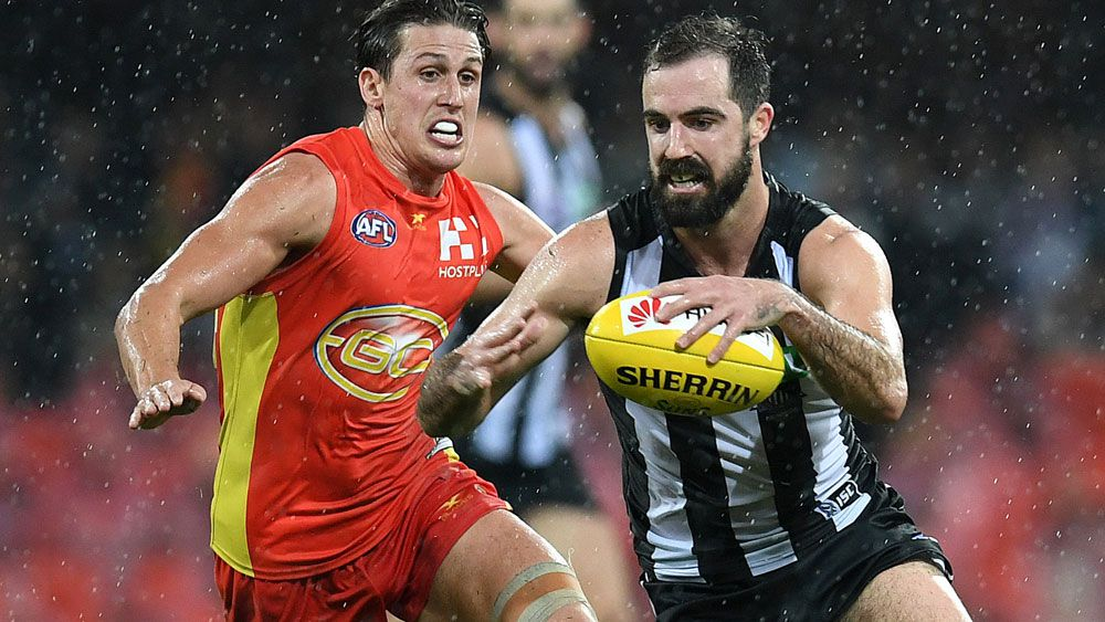 Pies ease pressure on Nathan Buckley with win over Suns