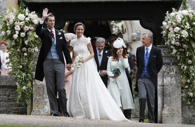 Pippa Middleton and James Matthews smile after their wedding at St Mark's Church in Englefield, England.