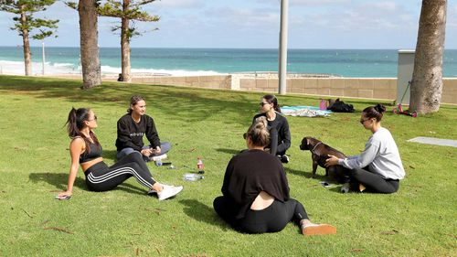 People are seen at Scarborough Beach in Perth.