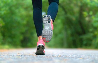 Woman running, close-up feet
