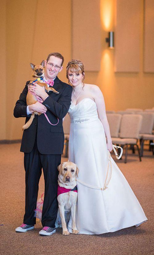 The newlyweds take a family photo. (Maddie Peschong)