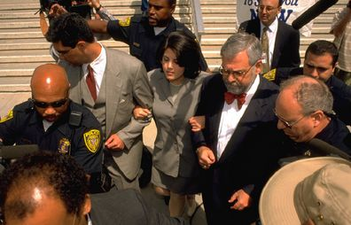 Monica Lewinsky goes to give FBI fingerprints hand writing samples.