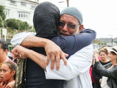 Jacinda Ardern comforts a mosque-goer in Wellington