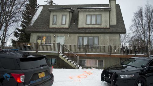 Alaska State Troopers investigate a fatal shooting scene at a home on North Valley Way in Palmer, Alaska.