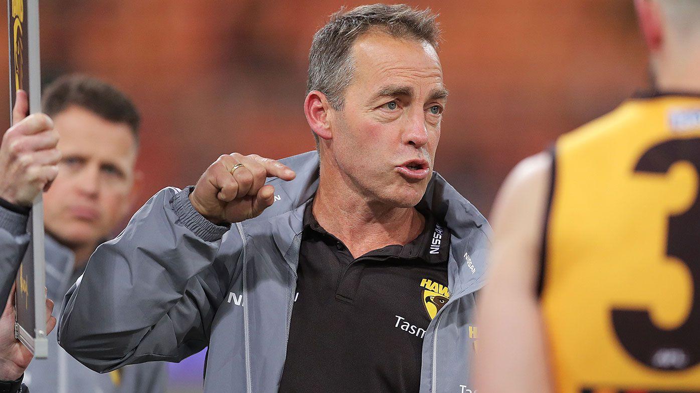 Hawks head coach Alastair Clarkson speaks to players