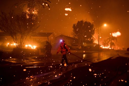 Strong winds push embers through the air during the Woolsey Fire