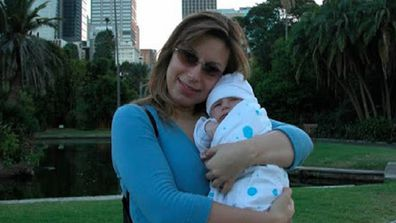 Jo Abi with her first child in 2004.