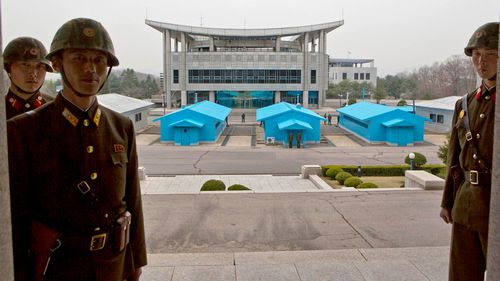 A file photograph shows North Korean soldiers standing on steps overlooking the border village of Panmunjom, which has separated the two Koreas since the Korean War. (AAP)
