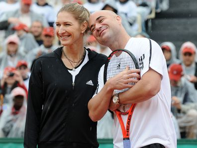 FRANCE - JUNE 06:  Andre Agassi and Steffi Graf in Roland-Garros for the Andre Agassi Foundation in Paris, France on June 06th, 2009 - Steffi Graf and Andre Agassi playing in Roland-Garros Tennis Tournament.  (Photo by Laurent ZABULON/Gamma-Rapho via Getty Images)