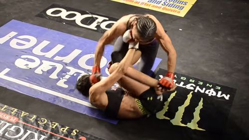 Sharice Davids used to be an MMA cage-fighter. In this screenshot, she's the fighter still standing.