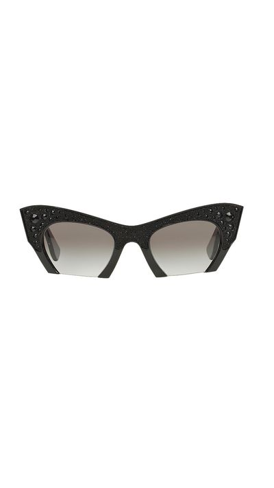 "<a href=""http://www.sunglasshut.com/au/8053672336962"" target=""_blank"">Sunglasses, $520, Miu Miu at Sunglass Hut</a>"