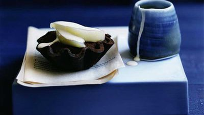 """Pear and chocolate fudge tartlets <a href=""""http://kitchen.nine.com.au/2016/05/19/17/06/pear-and-chocolate-fudge-tartlets"""" target=""""_top"""">recipe</a>"""