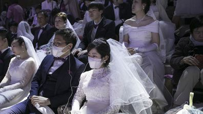 Some 4,000 'Moonies', believers of Unification Church, which was named after the founder Moon Sun Myung, attend the mass wedding which began in the early 1960s.