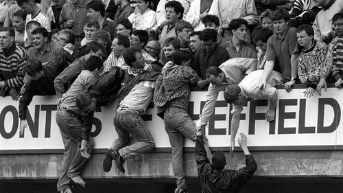 Liverpool fans trying to escape severe overcrowding during the FA Cup semi-final football match between Liverpool and Nottingham Forest at Hillsborough in 1989. Picture: AAP