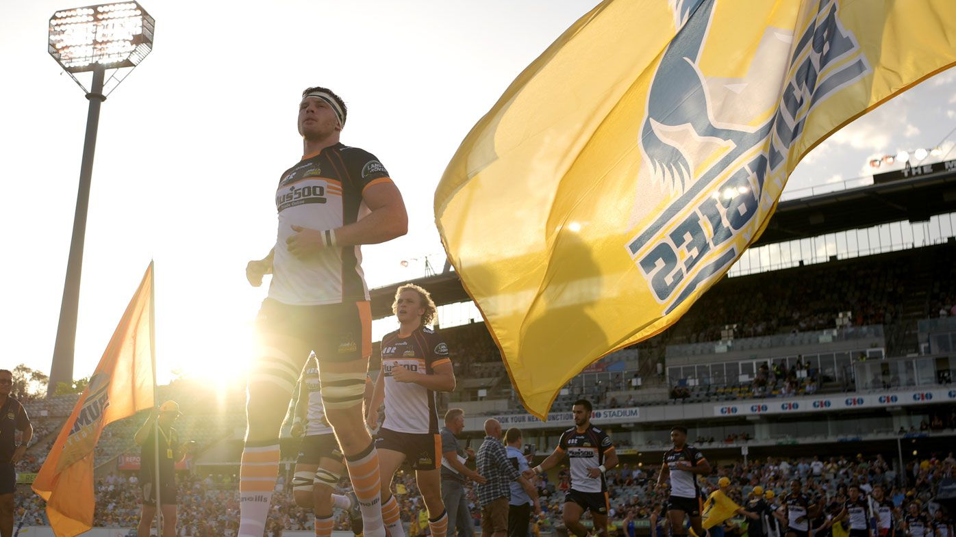 The Brumbies run out before the round one Super Rugby match between the Brumbies and the Reds at GIO Stadium