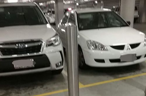 The elderly lady's car pictured on the right and the car she hit.