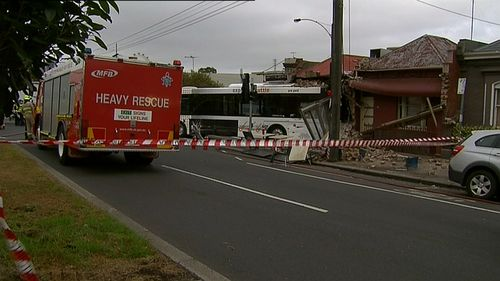 The bus driver was taken to hospital with minor injuries. (9NEWS)