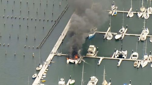 Smoke and flame poured into the air. (9NEWS)