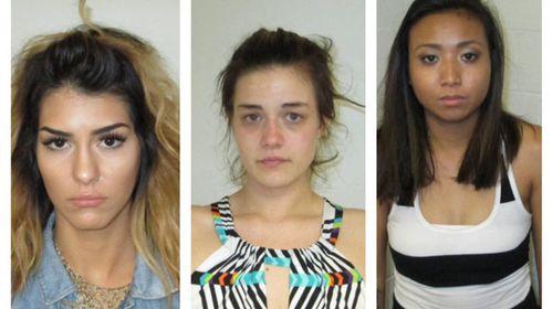 Women arrested after twerking outside police station
