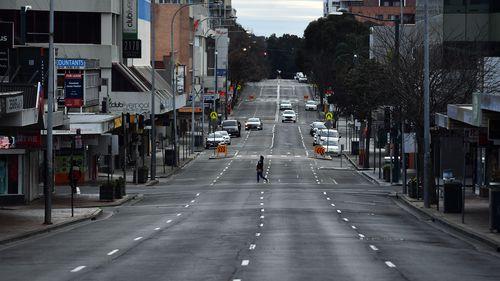 Shoppers walk on George Street in Liverpool, Sydney.